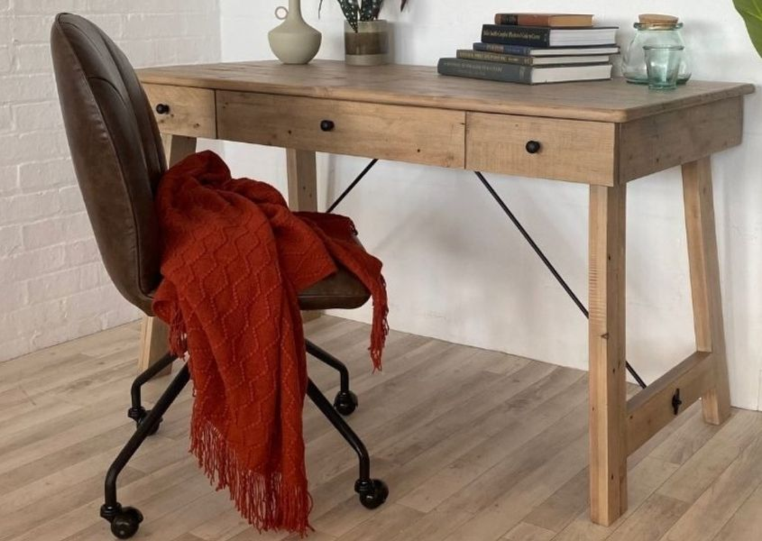 Brown faux leather office chair and wooden desk