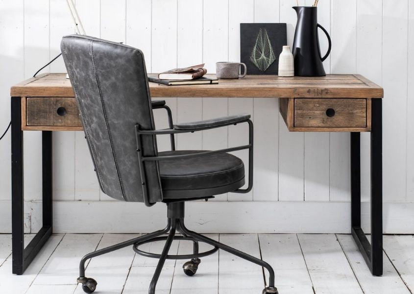 grey faux leather office chair next to industrial desk with black metal legs