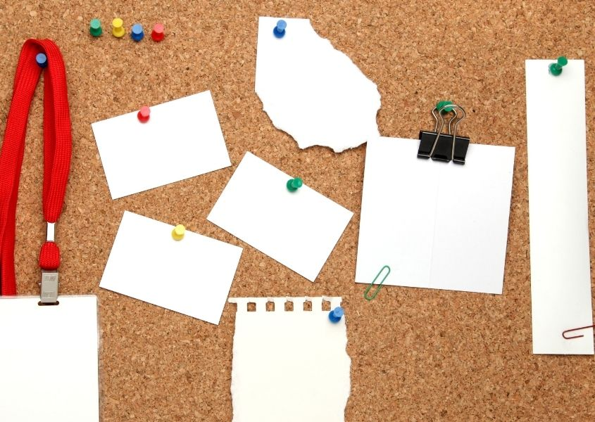 cork noticeboard with pieces of paper pinned for how to set up the perfect study space for your child blog