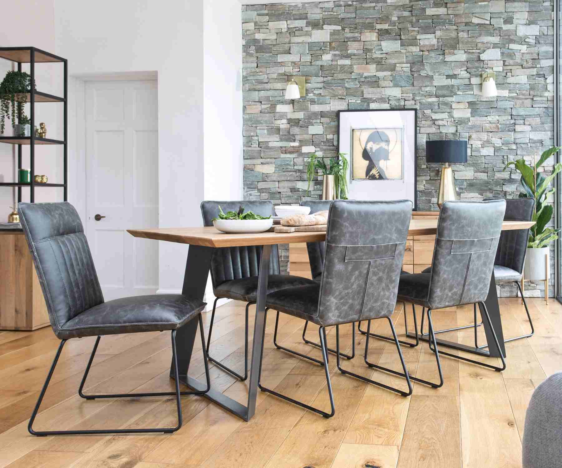 Grey faux leather dining chairs with industrial table