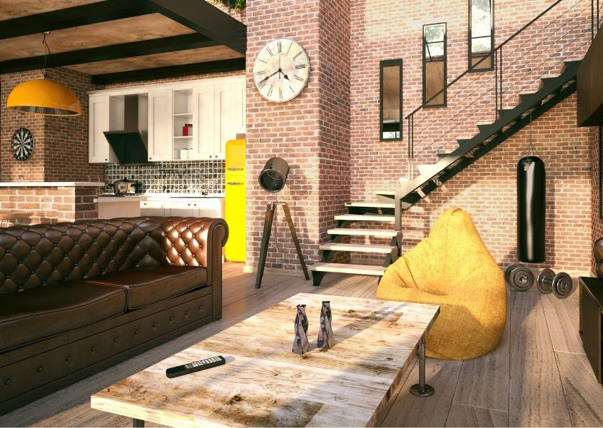 Industrial loft style living room with brown leather sofa and exposed brick walls