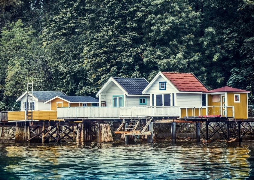 Colourful wooden houses on stilts over water
