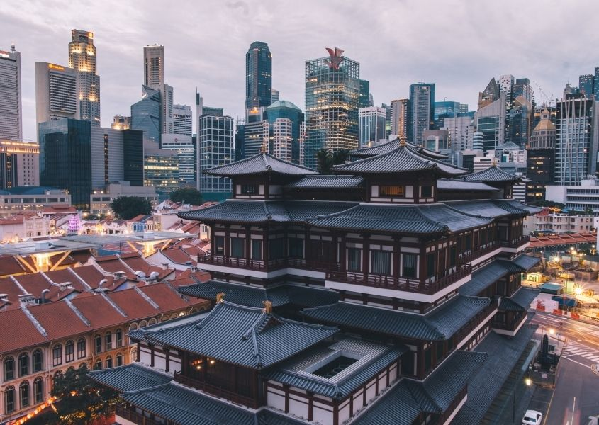 Old style buildings in Singapore with skyscrapers in the background