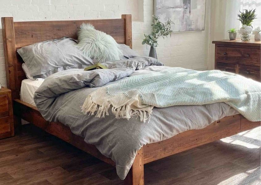 Reclaimed wood bed with grey covers and blanket