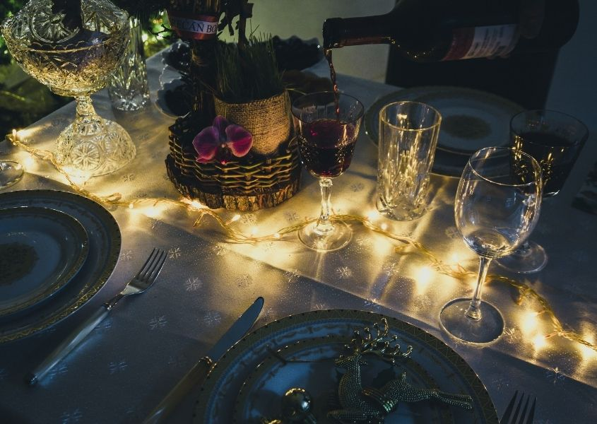 Close up of dining table with fairy lights lit up on the table