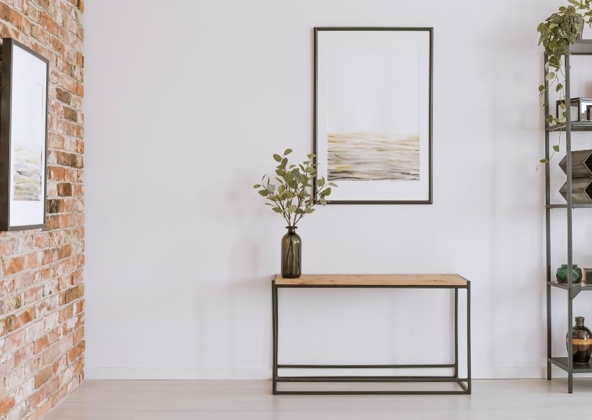industrial console table in hallway