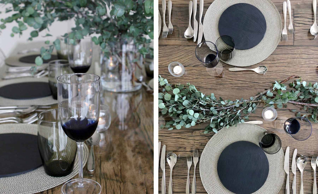 Silver and black round placemats and glasses