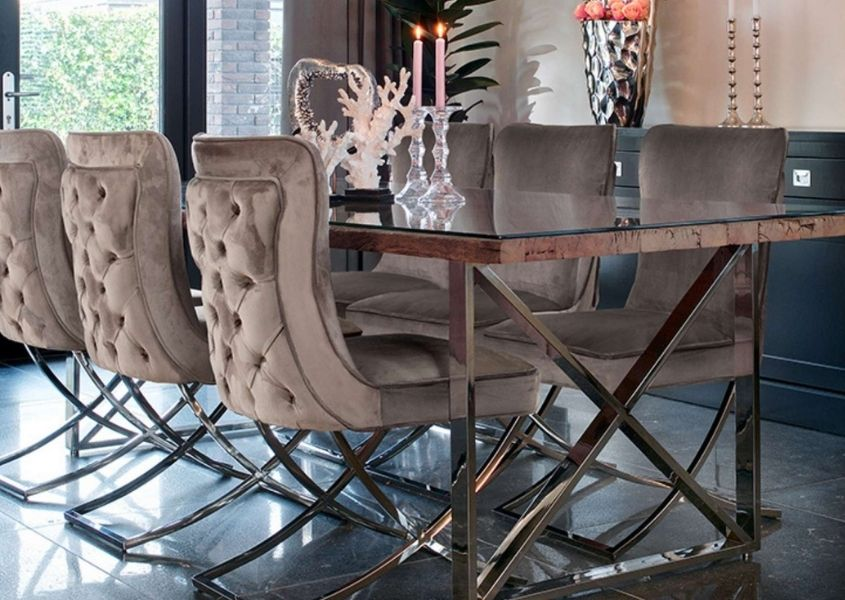 Reclaimed wood industrial dining table with stainless steel legs and grey velvet dining chairs