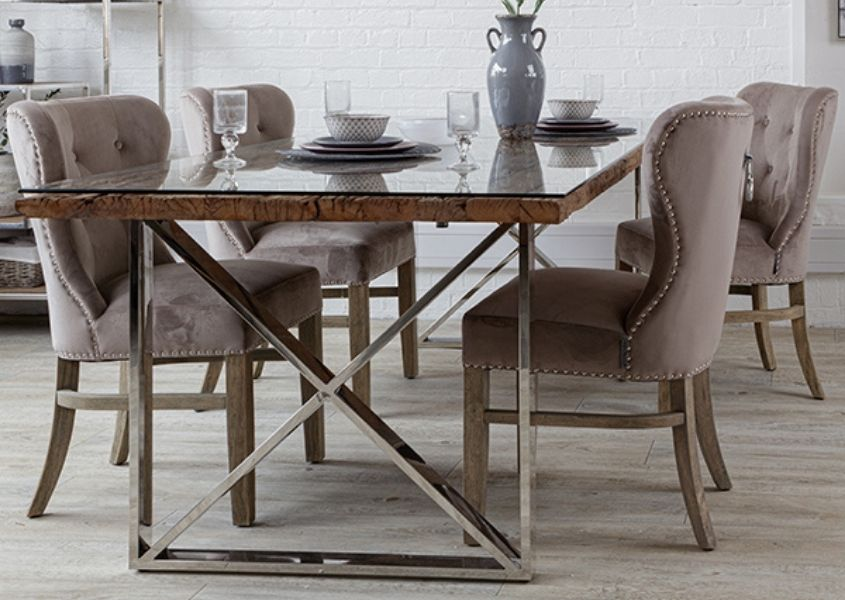 Reclaimed wood dining table with stainless steel metal legs and fabric dining chairs