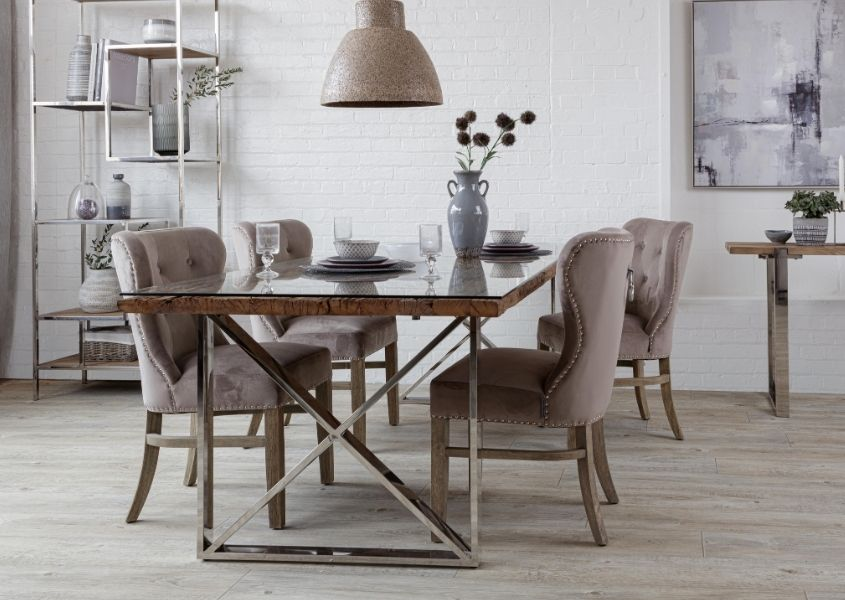 Industrial dining table with reclaimed wood top and grey fabric dining chairs