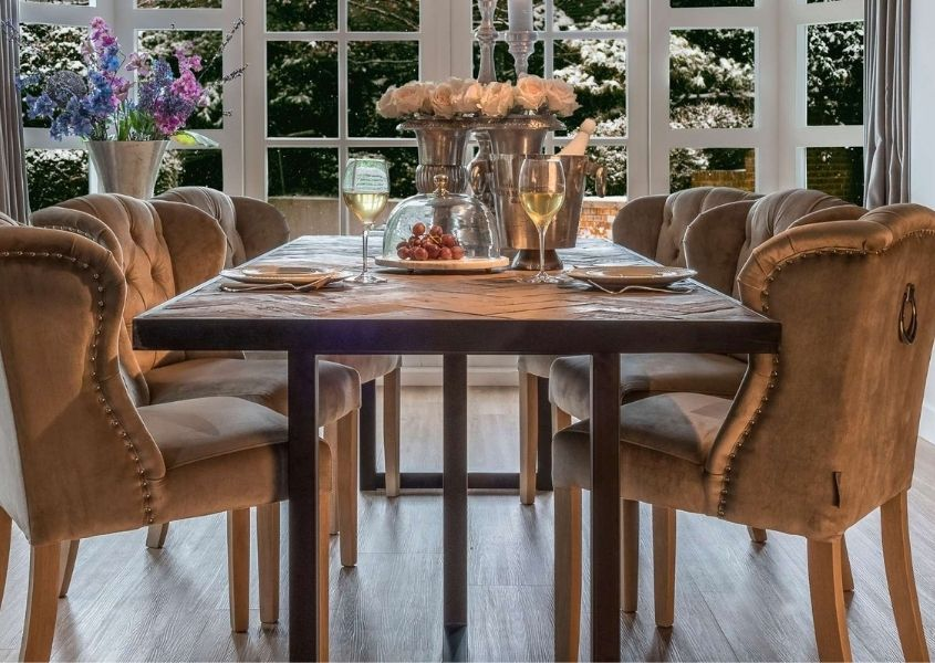 Industrial reclaimed wood dining table with velvet dining chairs