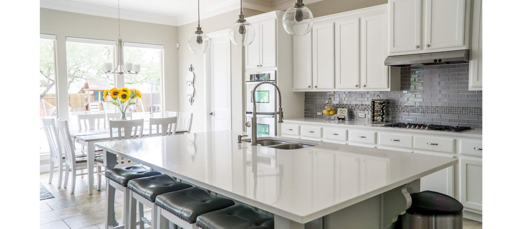 White kitchen with marble kitchen island