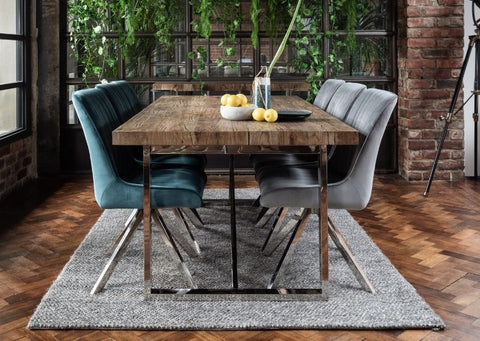 Velvet dining chairs with reclaimed wood industrial dining table