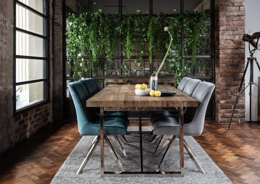 reclaimed wood dining table with grey and blue velvet dining chairs