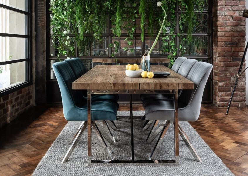 Reclaimed wood dining table with blue and grey velvet dining chairs