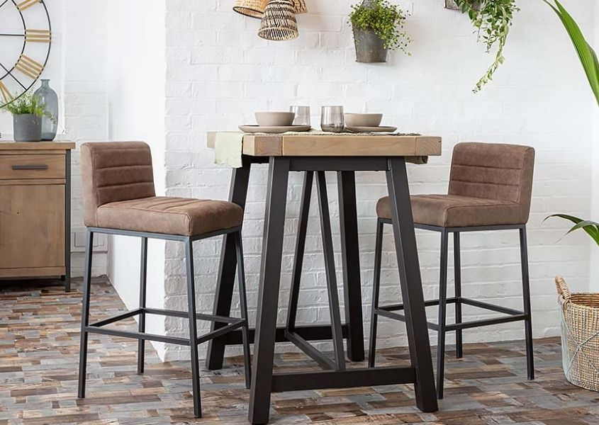 Brown faux leather bar stools with industrial bar table