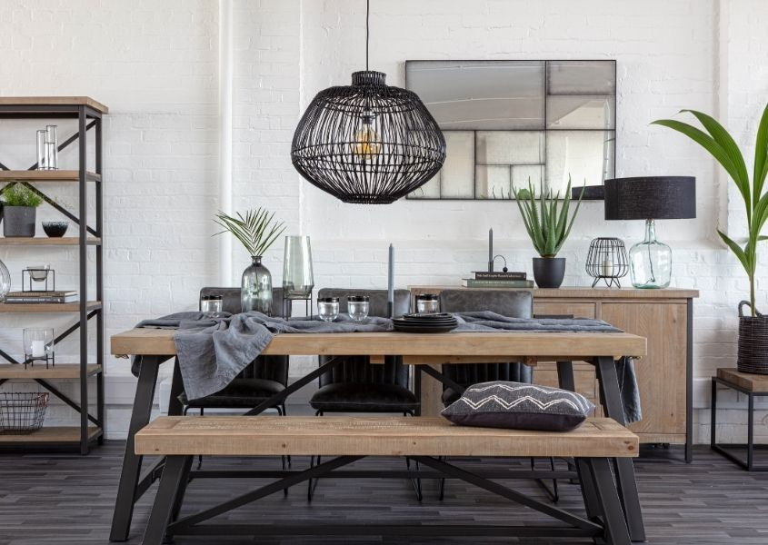 Industrial dining table with dark grey steel frame, matching wooden bench and black bamboo hanging ceiling light