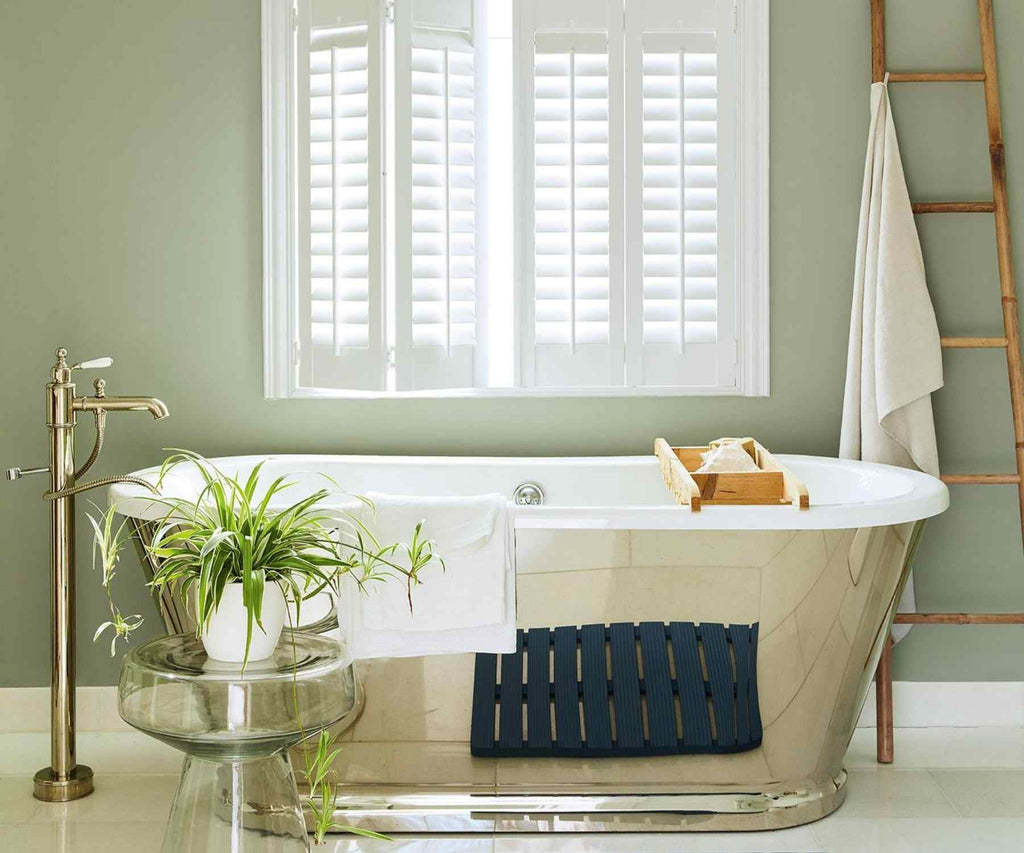 Metal roll top bath tub with white shutters