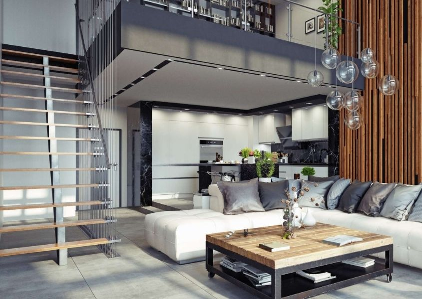 Industrial loft style living room with large grey metal staircase and industrial coffee table