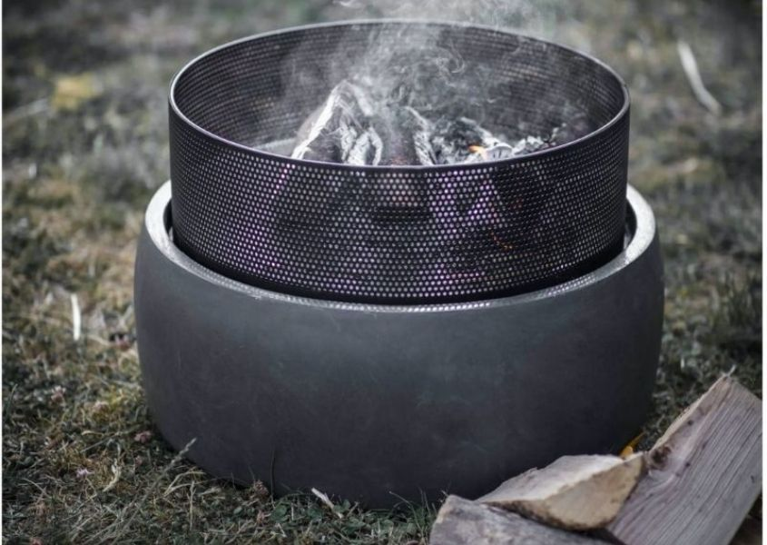 Small round steel fire pit with concrete base