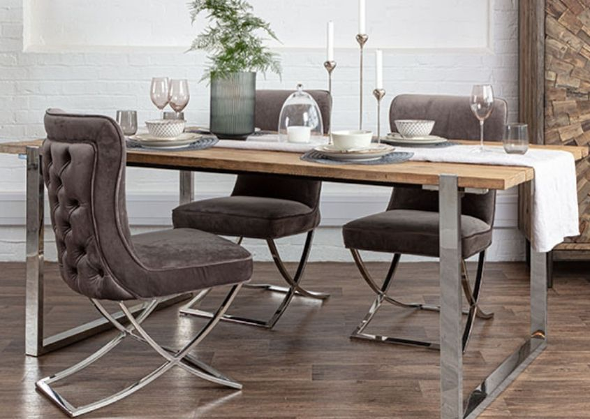 Reclaimed wood dining table with steel frame and fabric dining chairs and