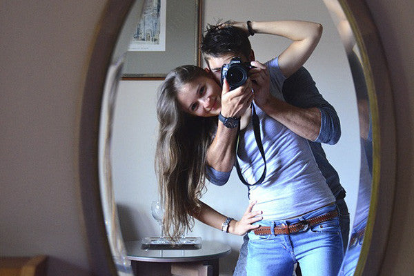 couple in front of mirror
