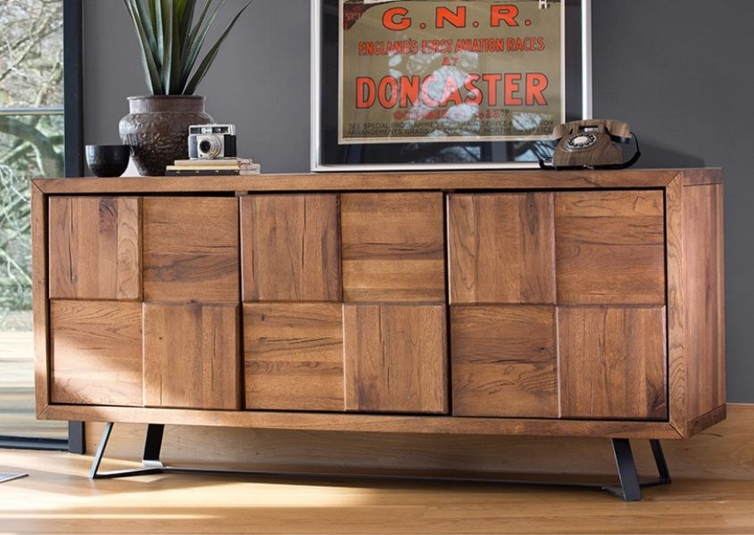 Mid century style sideboard against grey wall with ornaments on top and print behind