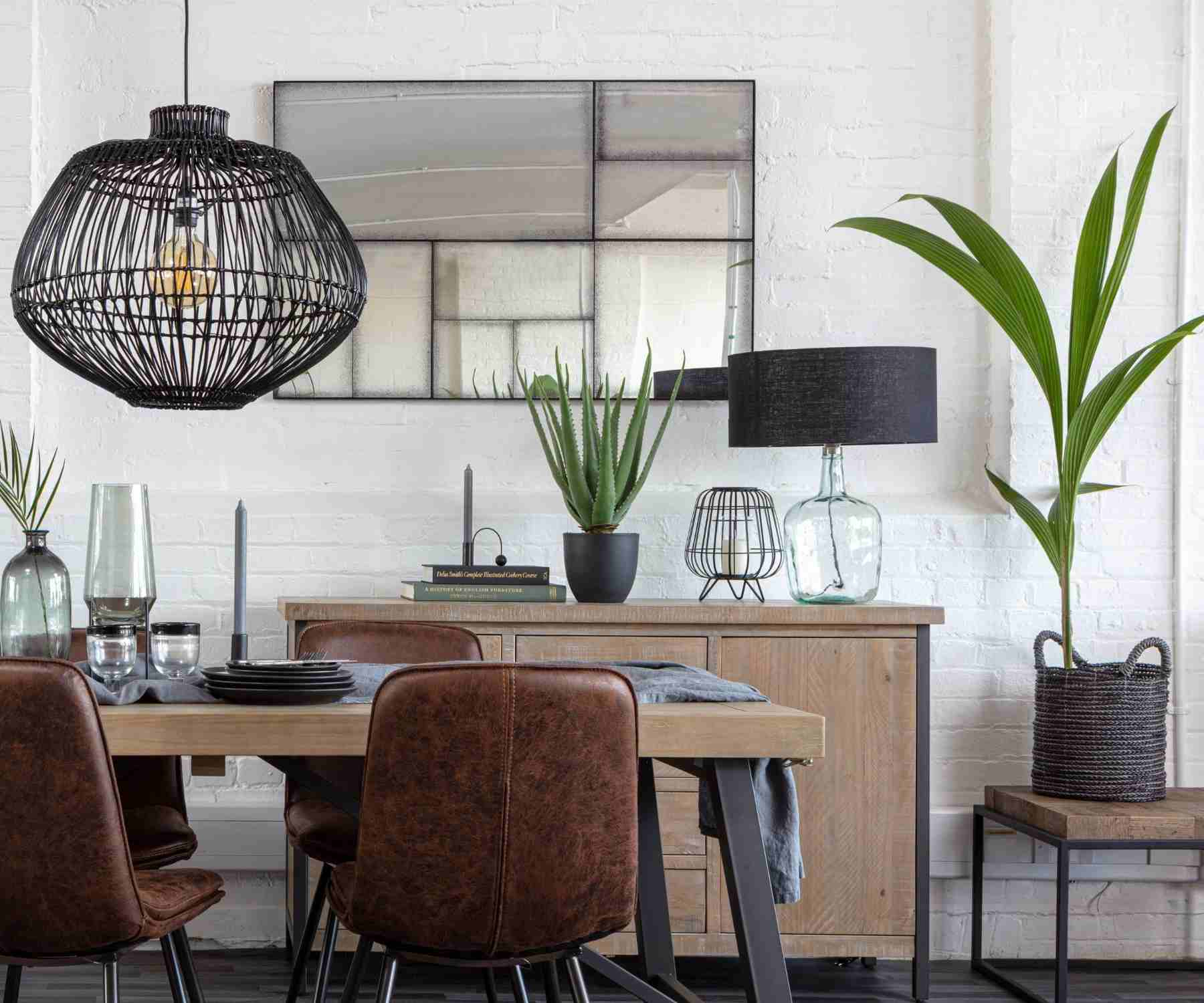 Reclaimed wood dining table with faux leather chairs and black pendant light