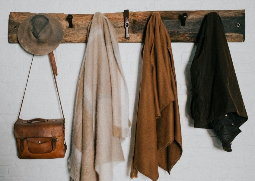 coats and bags on rustic wooden rack