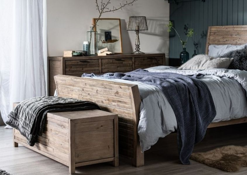 reclaimed wooden bed frame with wooden blanket box