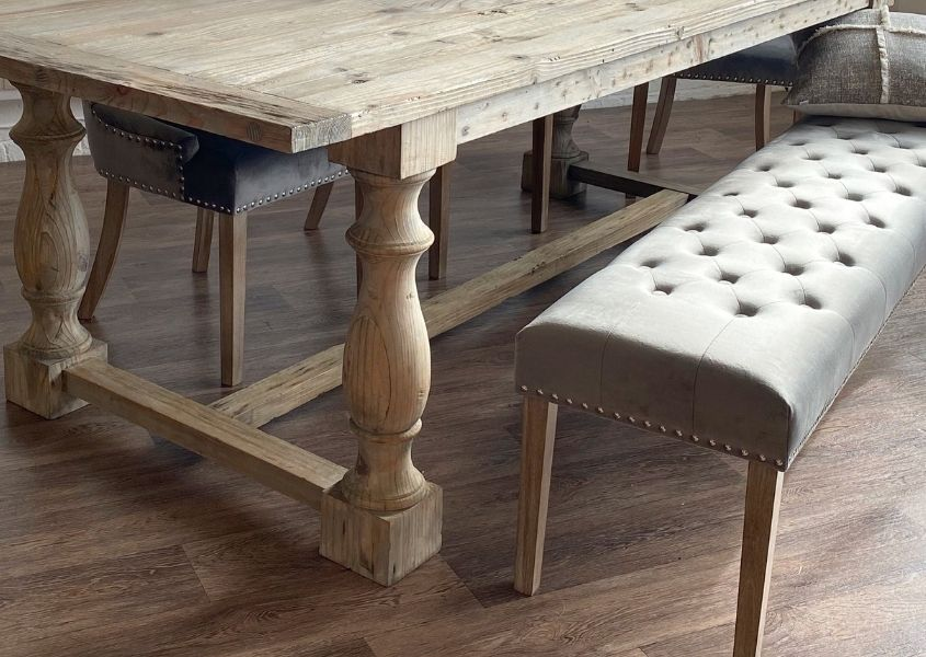 Rustic farmhouse dining table with grey fabric dining bench