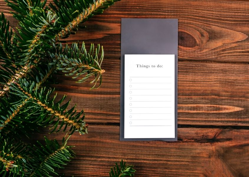Rustic wood background with pine needles and to do list