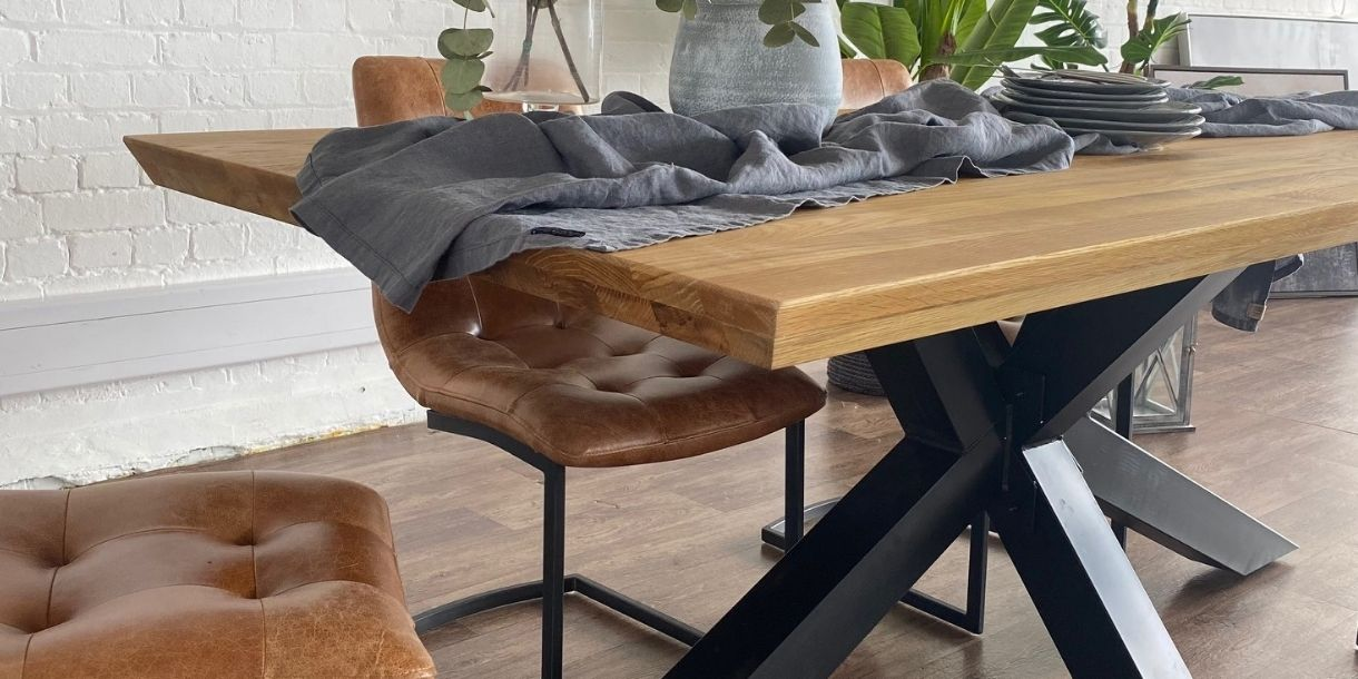 rustic oak industrial dining table with black metal spider leg