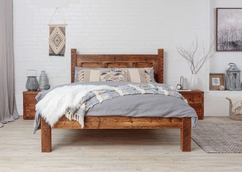 King size wooden bed frame with grey and white covers