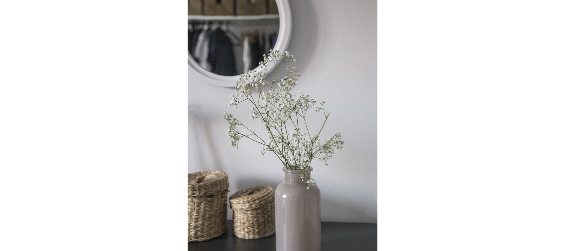 Grey vase with white flowers