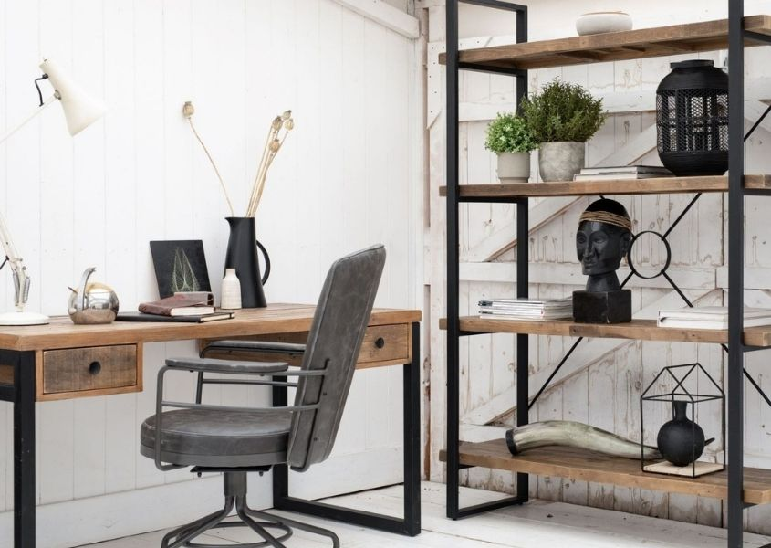 Industrial style home office with reclaimed wood industrial desk, industrial bookcase and grey faux leather swivel desk chair