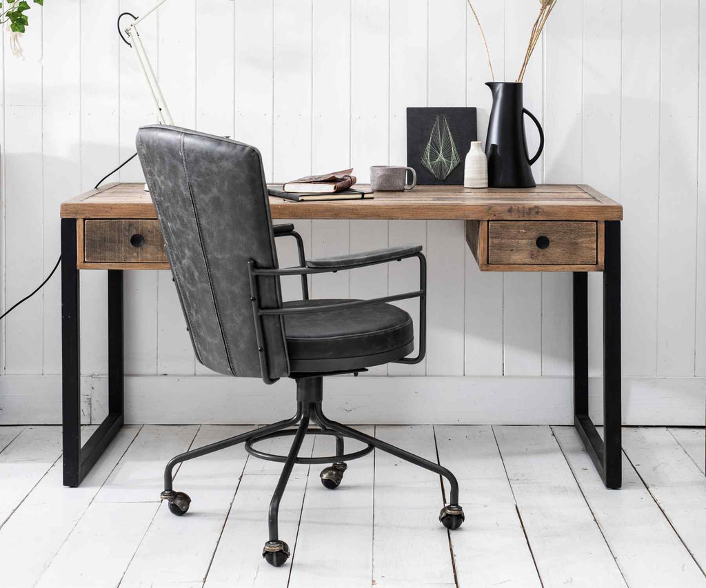 Grey office chair and reclaimed wood desk