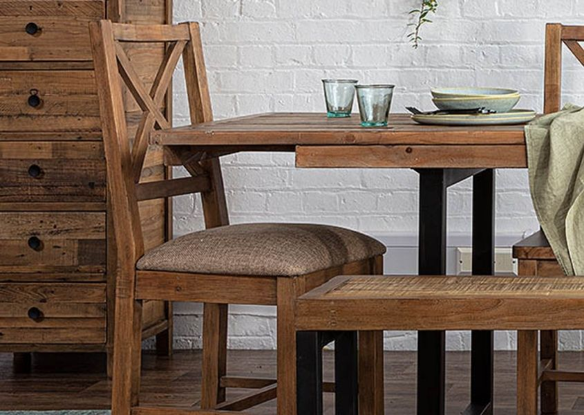 Reclaimed wood dining chair next to industrial dining table