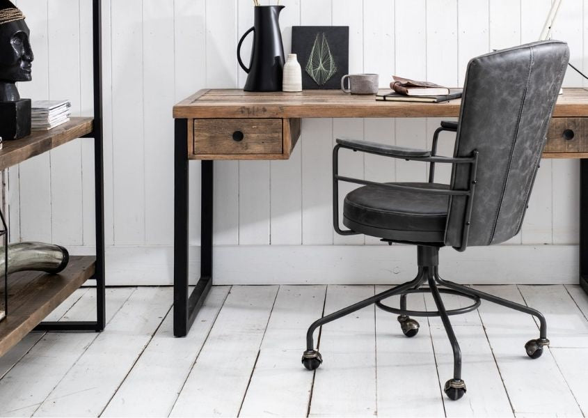 grey faux leather office chair next to industrial style desk