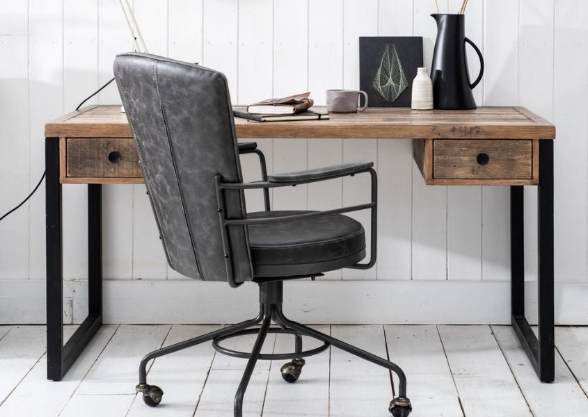 industrial desk with black steel legs, two drawers and grey faux leather office chair
