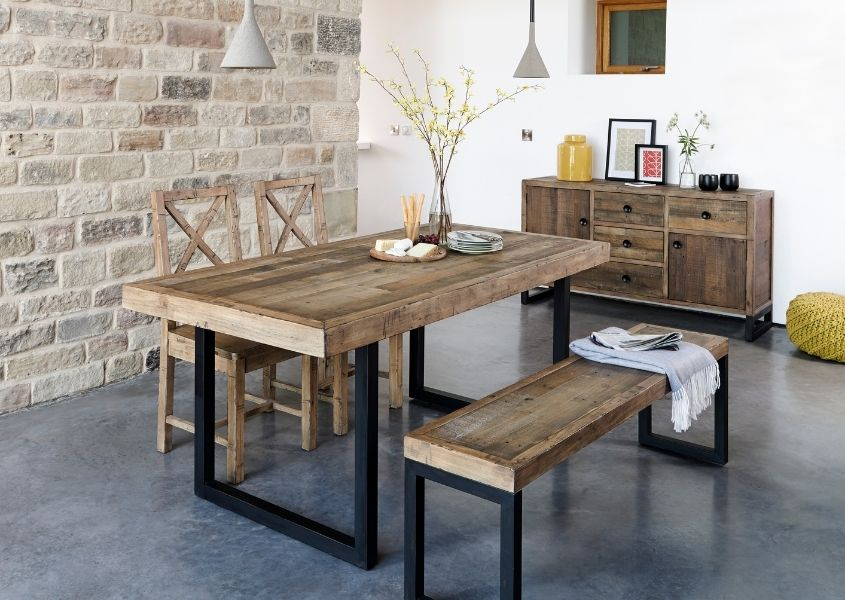Industrial dining table with wooden bench and reclaimed wood chairs