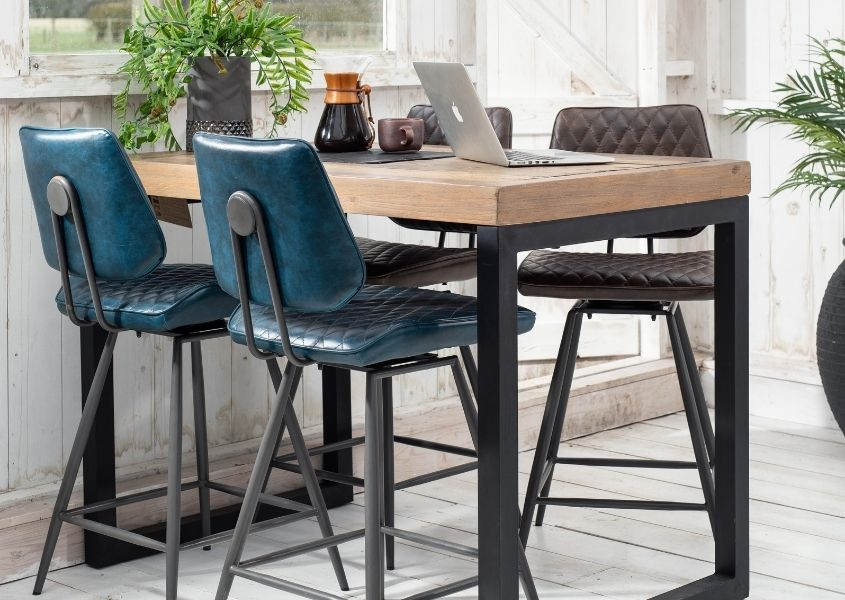 Industrial bar table in reclaimed wood with blue faux leather bar stools