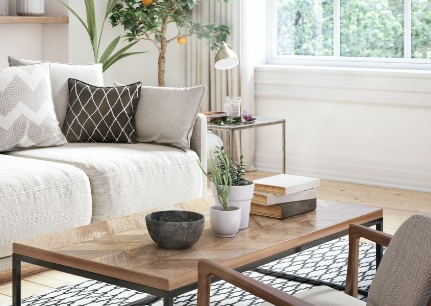 Industrial coffee table with books and plants