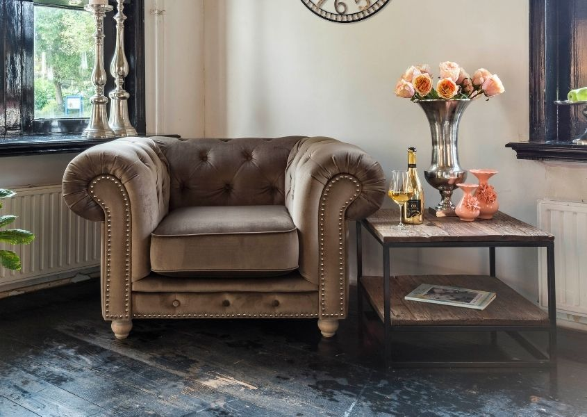 Brown leather armchair and industrial side table for Style tips to transform your coffee table blog