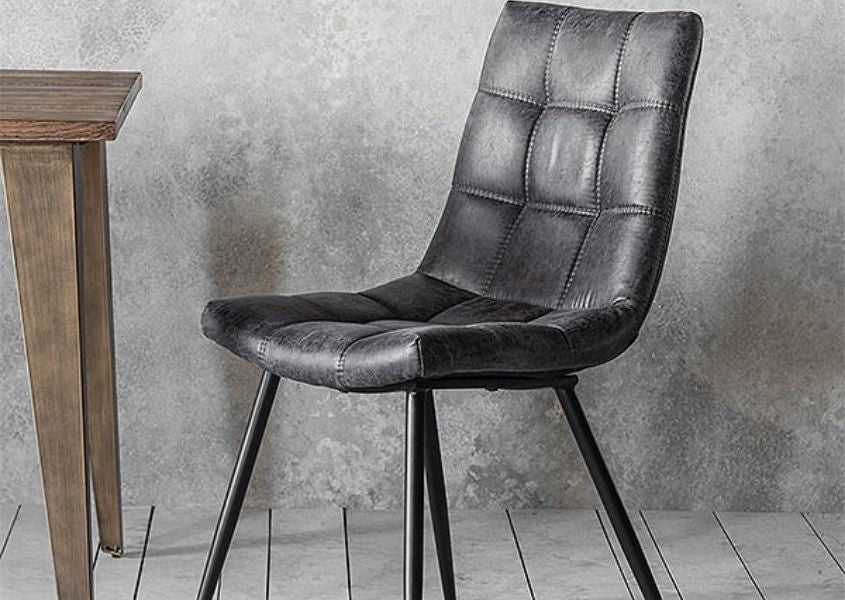 Grey faux leather dining chair with industrial style legs