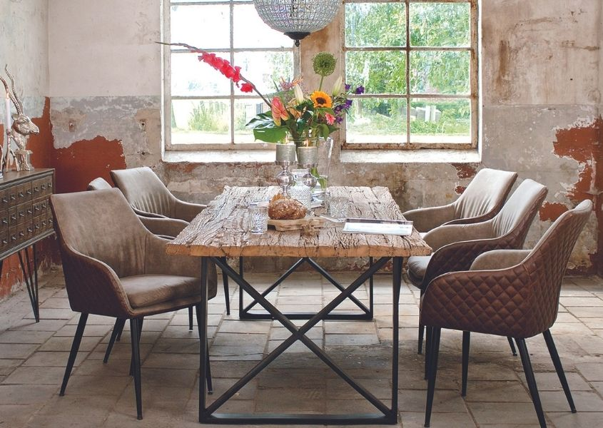 industrial dining table with large vase of flowers