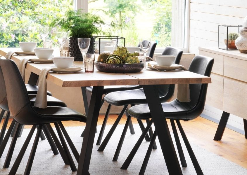 wooden dining table with black wooden legs