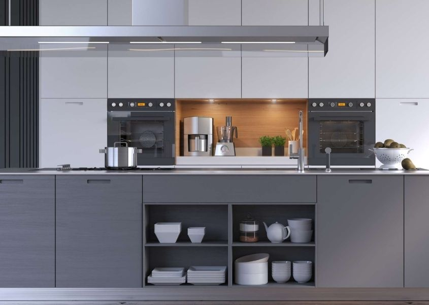 Contemporary kitchen with dark grey units and tall white kitchen units with long modern extractor fan