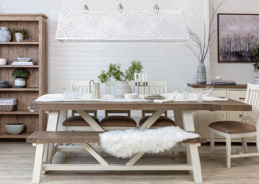 reclaimed wood dining table with white painted trestle legs and matching wooden bench