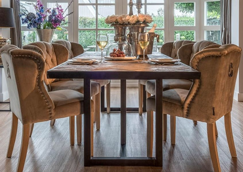Reclaimed wood industrial dining table with fabric dining chairs